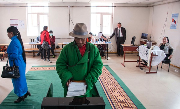 A villager casts his vote for the parliamentary elections at a polling station in Mandalgovi in the middle of Gobi province