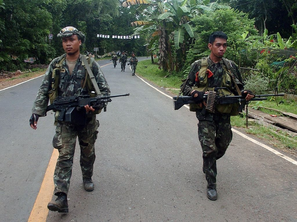 Philippine marines patrol a highway on the southern island of Mindanao as they continue their hunt for Abu Sayyaf militants