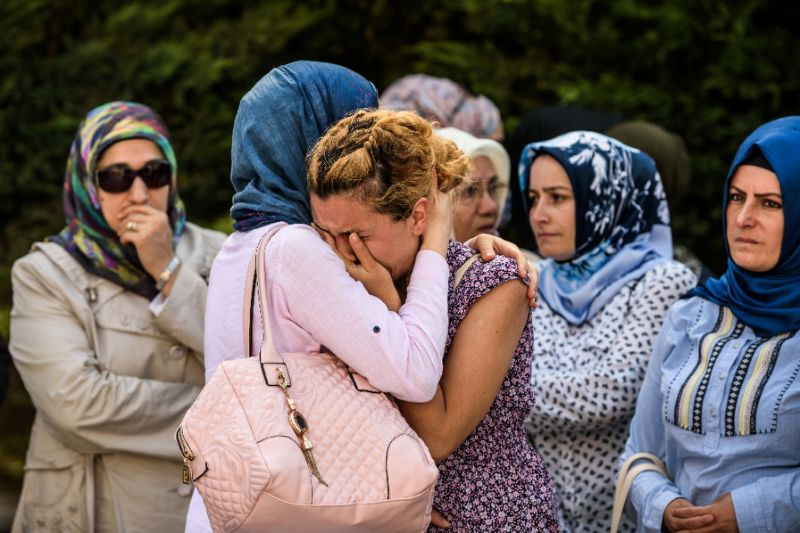 Relatives of suicide attack victim Mohammad Eymen Demirci mourn on June 29, 2016 in Istanbul