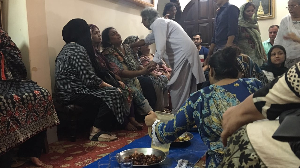 The sister of Amjad Sabir being consoled by relatives at her home in Karachi *PHOTO CREDIT - ALJAZEERA