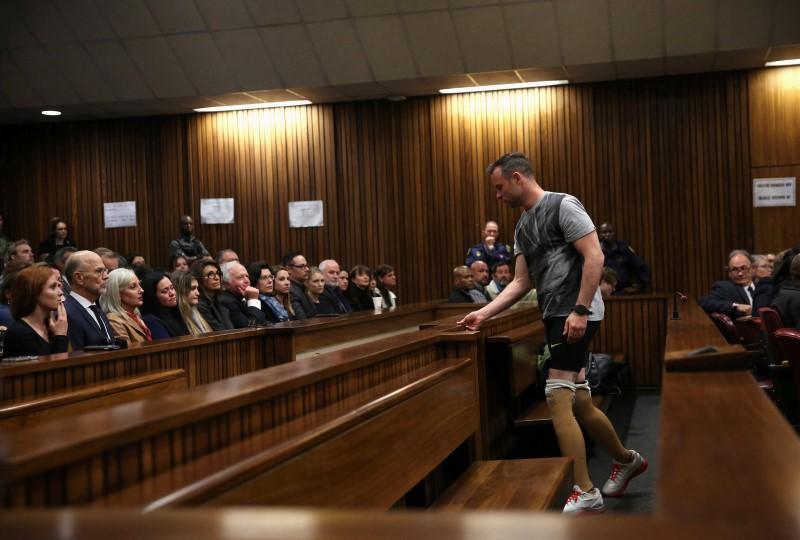 Paralympic gold medalist Oscar Pistorius prepares to walk across the courtroom without his prosthetic legs during the third day of the resentencing hearing for the 2013 murder of his girlfriend Reeva Steenkamp, at Pretoria High Court, South Africa June 15, 2016. REUTERS/Siphiwe Sibeko