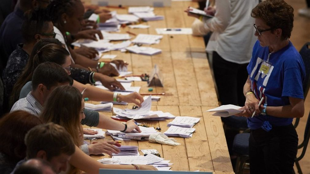Vote counting staff sort ballot papers at a vote counting centre at The Royal Horticultural Halls in central London on Jun 23, 2016