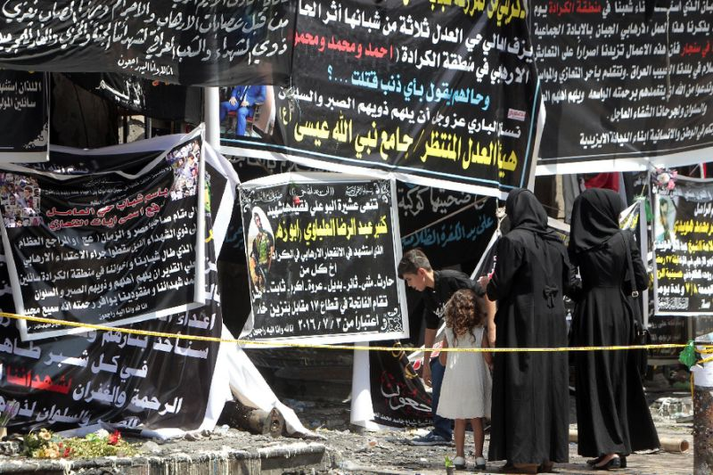 Iraqis gather at a memorial to victims of a bombing which claimed the lives of over 200 people in Baghdad's Karrada neighbourhood, one of the deadliest ever bombings in the country