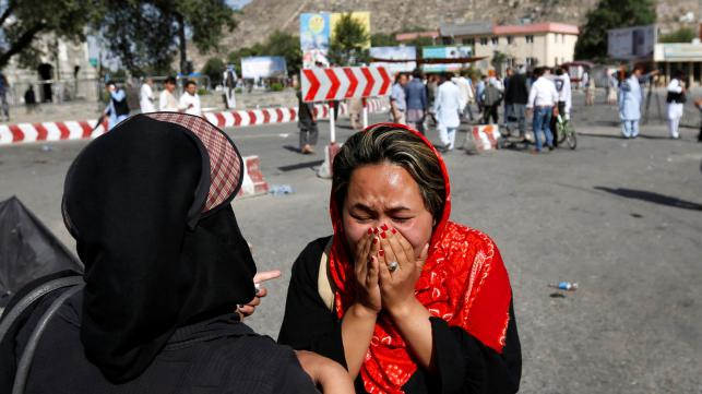 An Afghan woman weeps at the site of a suicide attack in Kabul, Afghanistan.