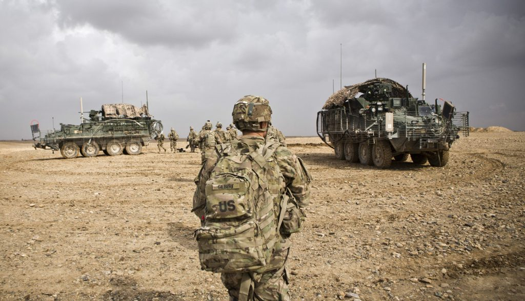 U.S. Army soldiers with Charlie Company, 36th Infantry Regiment, 1st Armored Division head back to their vehicles at the end of a mission near Command Outpost Pa'in Kalay in Maiwand District, Kandahar Province, February 3, 2013. REUTERS/Andrew Burton (AFGHANISTAN - Tags: MILITARY CONFLICT) - RTR3DB1Q
