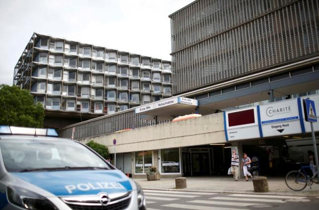 A police car is parked in front of the university clinic in Steglitz, a southwestern district of Berlin, July 26, 2016 after a doctor had been shot at and the gunman had killed himself
