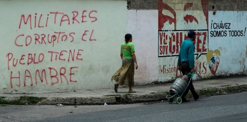"""Inscription on a wall in the low income Santa Rita neighborhood in Maracay, 70km from Caracas, reads """"Corrupt military, the people are hungry"""""""
