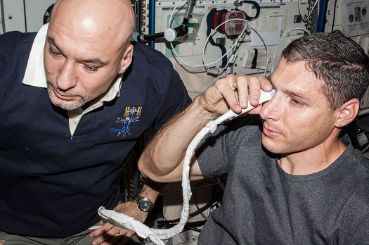 NASA astronaut Michael Hopkins and European Space Agency astronaut Luca Parmitano perform ultrasound eye imaging as part of the Fluid Shifts investigation during Expedition 37 on the International Space Station * PHOTO: NASA