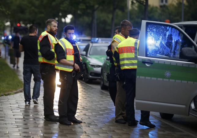 Police secure a street near to the scene of a shooting in Munich * PHOTO: REUTERS