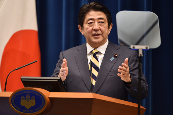 Abe claims win in Japan parliamentary poll