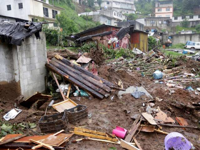 Damaged houses and debris are seen after a mudslide following heavy showers caused by the passing of Tropical Storm Earl, in the town of Huauchinango, in Puebla state, Mexico, August 7, 2016. PHOTO: REUTERS