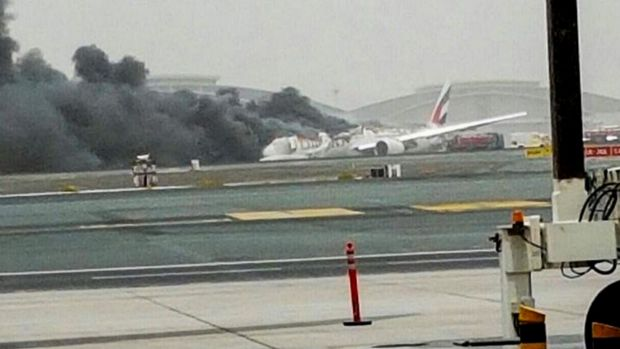 "An Emirates plane has caught alight after making a ""crash-landing"" at Dubai Airport"