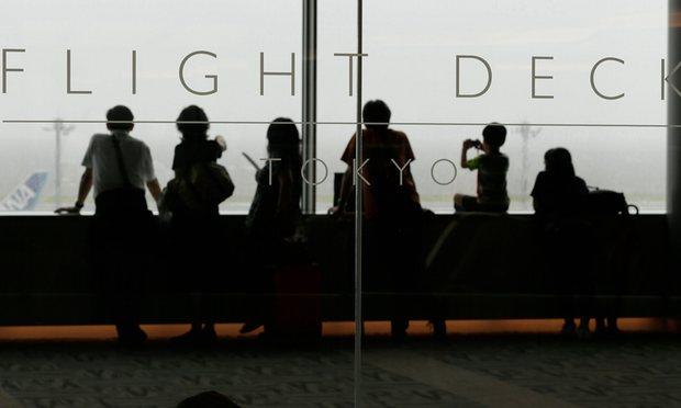 Passengers wait at Haneda airport in Tokyo as typhoon Mindulle hit eastern Japan