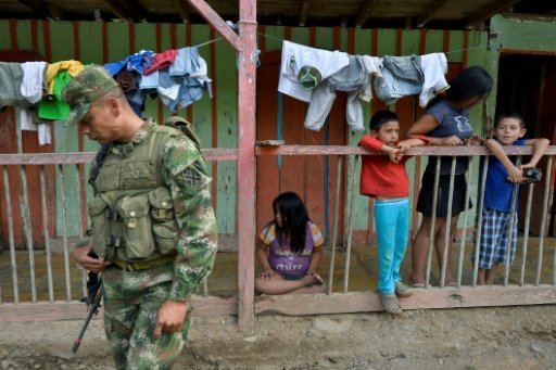 Many victims of Columbia's half-century conflict will have to learn to live alongside former fighters if the demobilization of the Revolutionary Armed Forces of Colombia (FARC) goes ahead * PHOTO : AFP