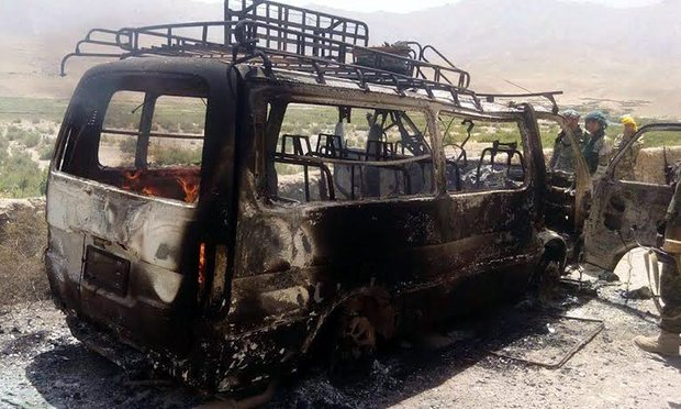 Afghan security officials inspect a van that was believed to have been transporting foreign tourists when it was attacked by militants in Herat province * PHOTO : EPA