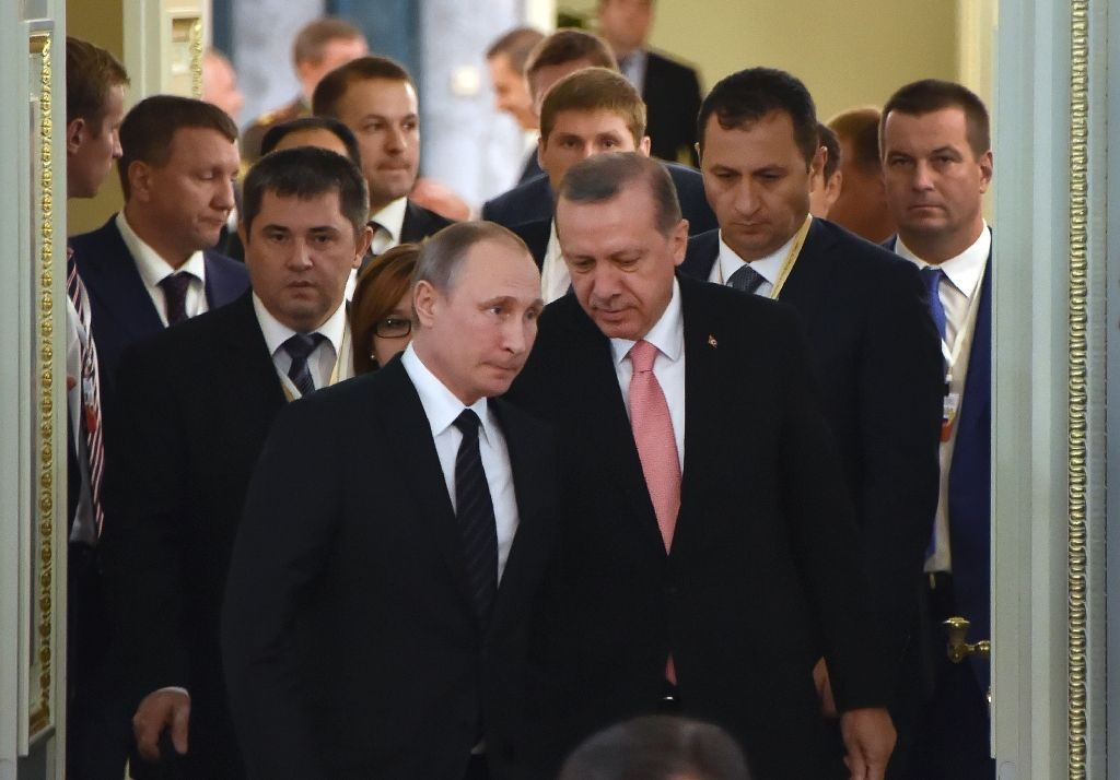 Russian President Vladimir Putin (C-L) and his Turkish counterpart Recep Tayyip Erdogan enter a hall to start their meeting with Russian and Turkish entrepreneurs, at Konstantinovsky Palace outside St. Petersburg, on August 9, 2016