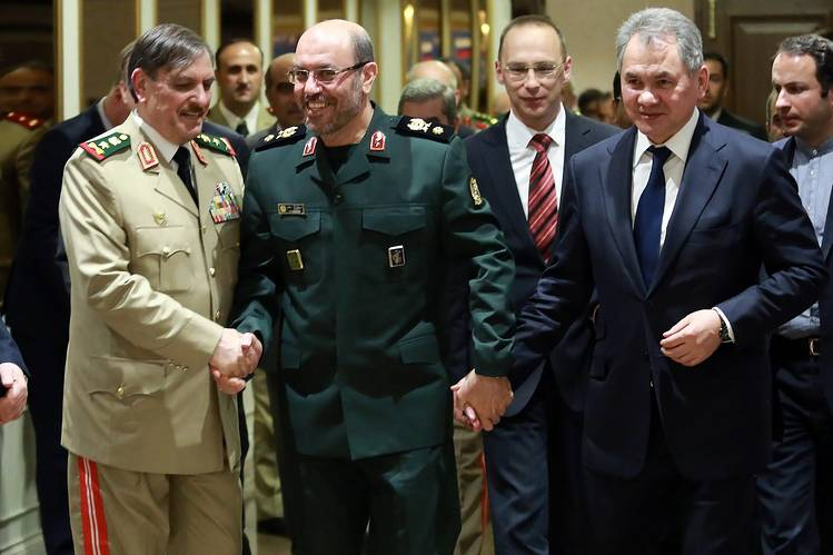 Iranian Defense Minister Hossein Dehghan, center, greeting his counterparts from Russia, Sergei Shoigu, right, and Syria, Jassim al-Freij, before a meeting in Tehran on June 9. PHOTO: EUROPEAN PRESSPHOTO AGENCY