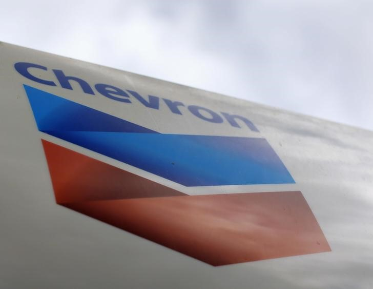 A Chevron gas station sign is pictured at one of their retain gas stations in Cardiff, California