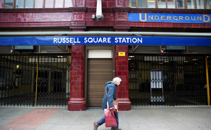 Man passing by the Russel Square Station in London