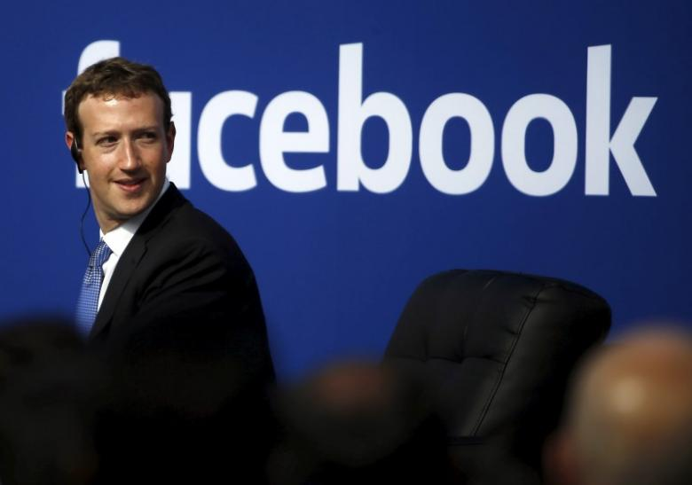 Facebook CEO Mark Zuckerberg is seen on stage during a town hall at Facebook's headquarters in Menlo Park, California