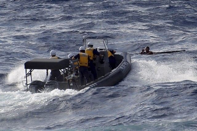 The Japan coast guard rescues a crew member from a Chinese fishing boat that sunk following a collision with a Greek cargo vessel in the Senkaku islands yesterday