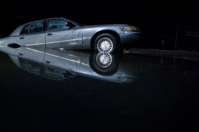 A car is seen partially submerged in flood waters on August 15, 2016 in Denham Springs, Louisiana