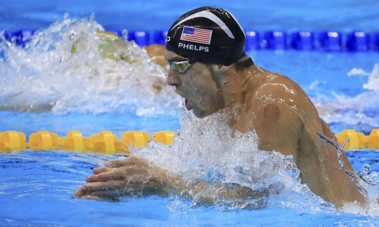 Michael Phelps (USA) of USA competes on the way to winning the gold medal.  REUTERS/Dominic Ebenbichler