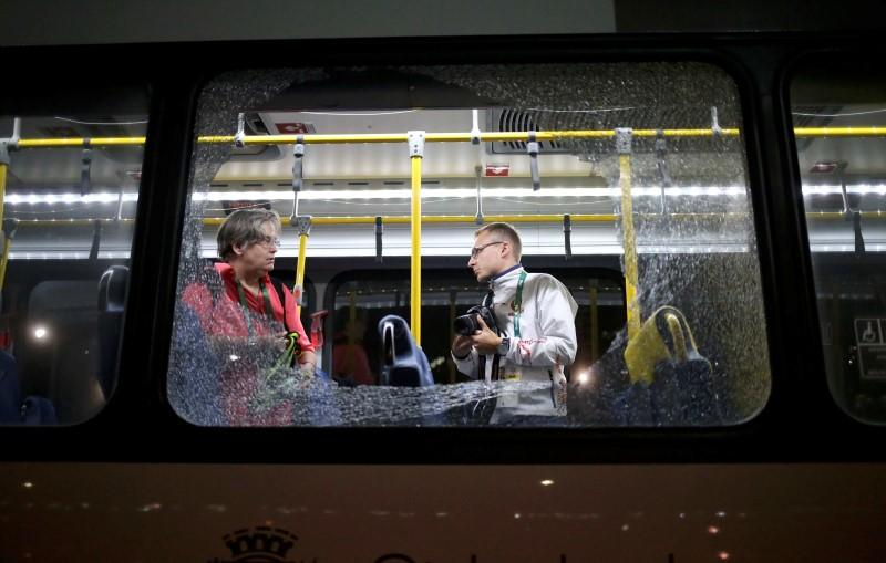 Broken windows on an official media bus after they shattered when driving accredited journalists to the Main Transport Mall from the Deodoro venue of the Rio 2016 Olympic Games in Rio de Janeiro, August 9, 2016. REUTERS/Adrees Latif