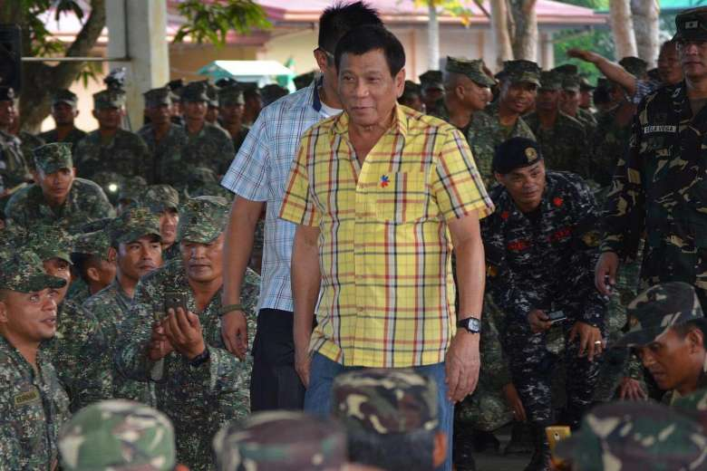 Philippine President Rodrigo Duterte arrives at a military camp in the town of Jolo, Sulu province on August 12