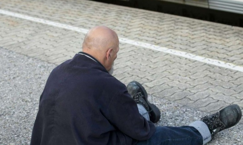 The suspect sits on a platform after he was arrested at a train station in Vorarlberg, Austria, after he had attacked two passengers with a knife * PHOTO : AFP