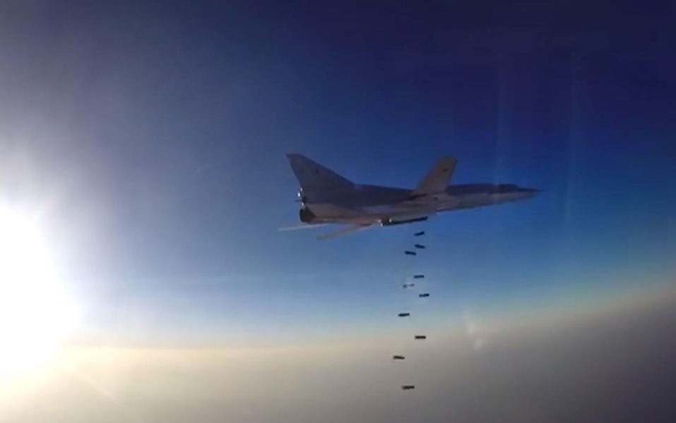 This video grab image created on August 16, 2016, taken from a footage released by the Russian Defence Ministry's official website, reportedly shows a Russian bomber Tupolev Tu-22M3 conducting airstrike