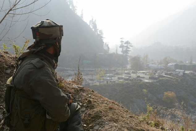 An Indian soldier keeps watch over the army barracks Gingal Uri, Kashmir