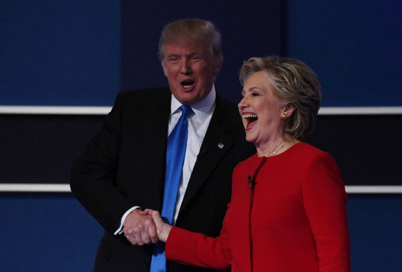 Hillary Clinton shakes hands with Donald Trump after the first presidential debate at Hofstra University