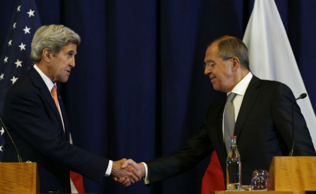 John Kerry, Sergei Lavrov shake hands at the conclusion of their press conference