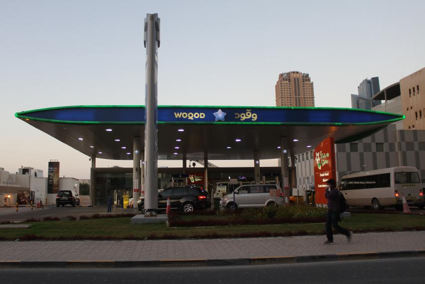 A man walks past Woqod oil station in Doha, Qatar