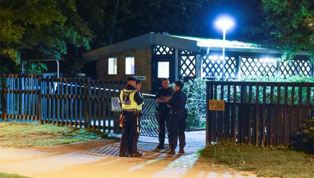 Police investigate the scene after the shooting in Malmo