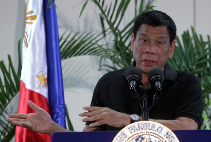Philippines President Rodrigo Duterte gestures during a news conference upon his arrival from a state visit in Vietnam at the International Airport in Davao city, Philippines