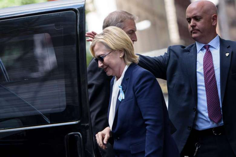 Hillary Clinton gets in her car while leaving her daughter's apartment building after resting on Sept 11, 2016, in New York