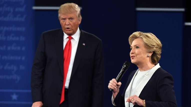 US Democratic presidential candidate Hillary Clinton, right, and US Republican presidential candidate Donald Trump during the second presidential debate at Washington University, St. Louis, Missouri