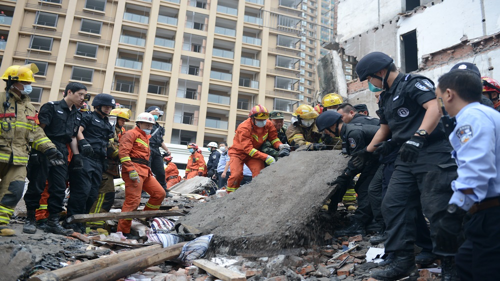 Rescue workers search at the site where residential buildings collapsed in Wenzhou, Zhejiang province, China