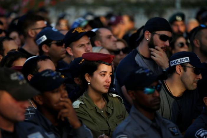 Family and friends mourn during the funeral of Israeli policeman Yosef Kirma, who was killed by a Palestinian assailant who fired from a car before being shot dead by Israeli police in Jerusalem, at Mount Herzl cemetery in Jerusalem