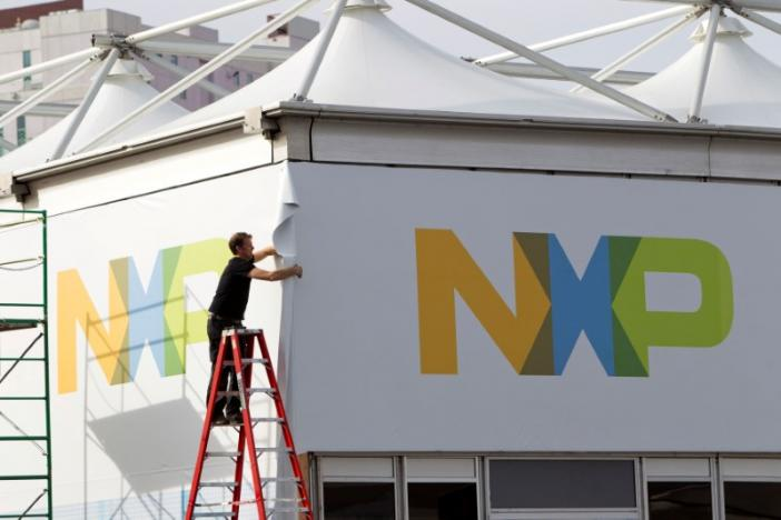A man works on a tent for NXP Semiconductors in preparation for the 2015 International Consumer Electronics Show (CES) at Las Vegas Convention Center in Las Vegas, Nevada
