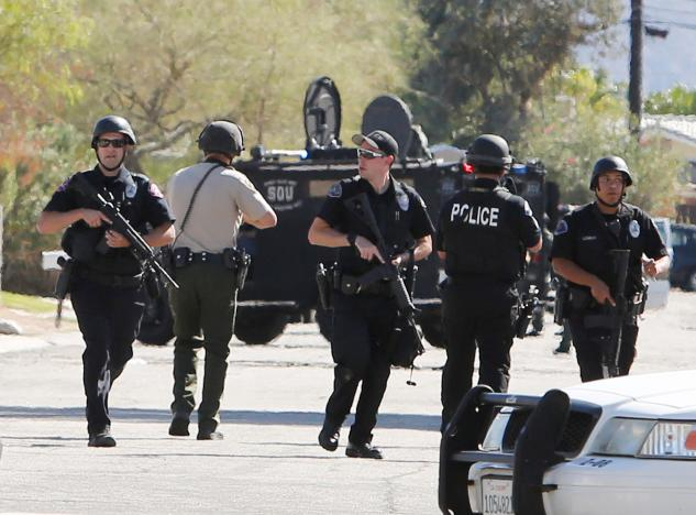 Armed police officers are shown during a standoff where three officers were shot by a suspect in Palm Springs, California, U.S. October 8, 2016.  REUTERS/Sam Mircovich