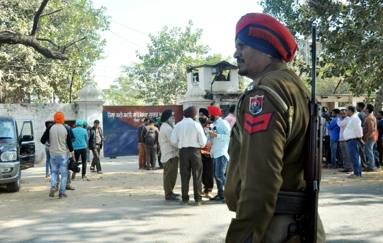 An Indian police officer stands near the gate of the Nabha maximum-security prison in Punjab state on November 27, 2016