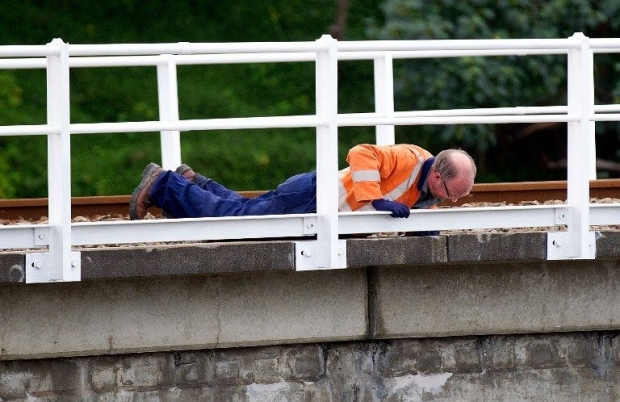 File picture of a Wellington engineer checking a rail bridge for structural damage after a 6.5 earthquake hit central New Zealand. A 7.4-magnitude quake rocked the country today - See more at: http://www.themalaymailonline.com/world/article/usgs-powerful-7.4-magnitude-quake-rattles-new-zealand#sthash.DuDTXv5v.dpuf