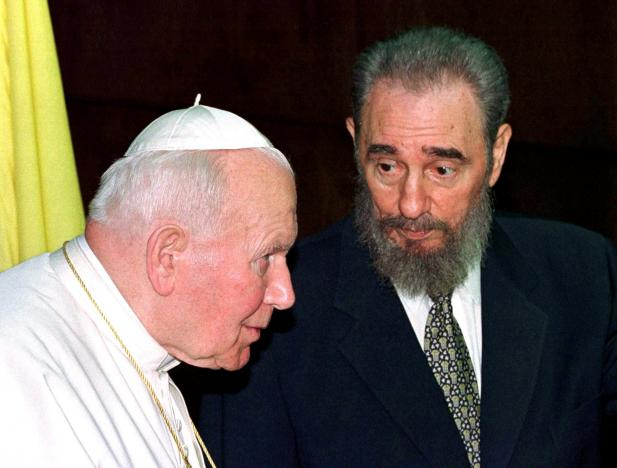 Then Cuban President Fidel Castro talks to then Pope John Paul II during the presentation of their delegations at the Palace of the Revolution in Havana