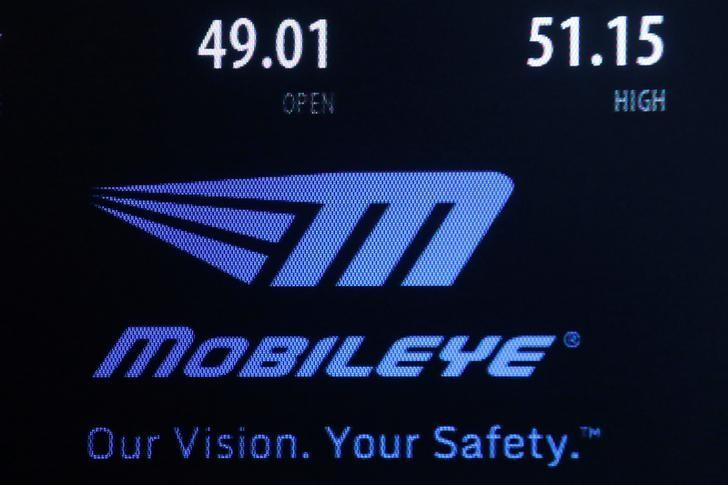A logo and stock information for auto supplier Mobileye NV is displayed on a screen where the stock is traded on the floor of the New York Stock Exchange (NYSE) in New York City