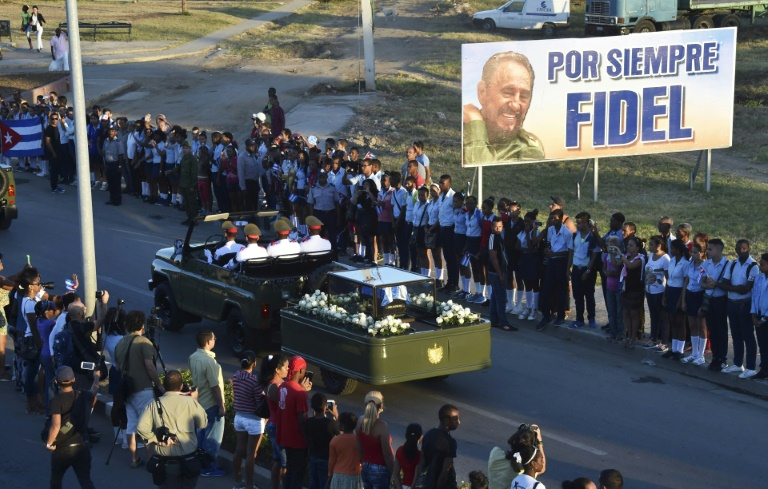 """As a military jeep drove Fidel Castro's urn thousands who lined the streets of Santiago shouted """"viva Fidel!"""""""