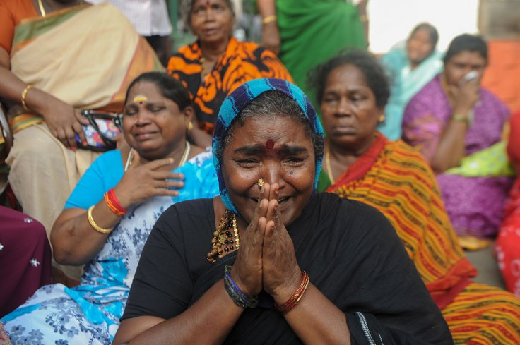 Supporters of Tamil Nadu state leader Jayalalithaa Jayaram cry in front of a hospital in Chennai where she was being treated
