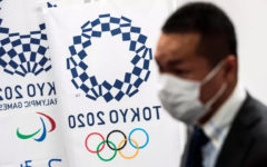 Olympic dreams on hold for Japan volunteers, hosts